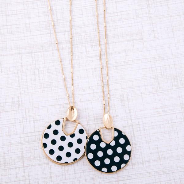 "Long Worn Gold enamel polka dot hinge disc pendant necklace.  - Pendant approximately 2"" in diameter - Approximately 32"" L overall - 3"" extender"
