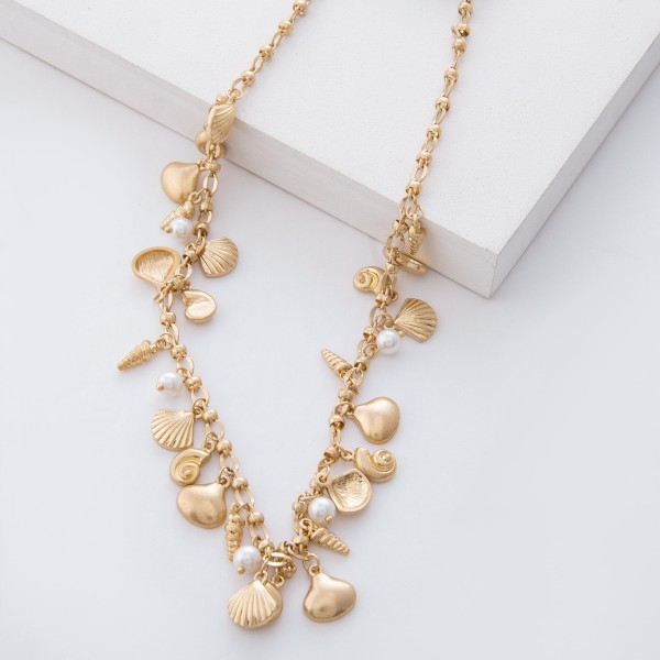 "Worn Gold Clam Seashell and Pearl Floater Necklace.  - Approximately 16"" L  - 3.5"" extender"