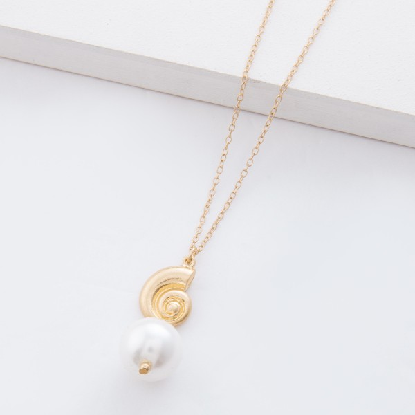 "Worn Gold Ivory Pearl Shell Necklace.  - Pearl 17mm - Pendant approximately 2"" L  - Approximately 18"" L overall - 3.5"" extender"