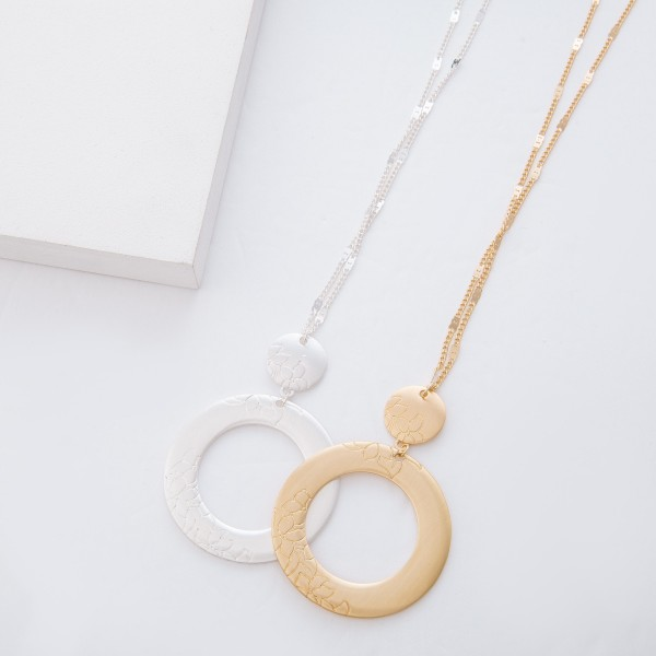 """Long Satin Gold Flower Stamped Circle Pendant Necklace.  - Pendant 3"""" L  - Approximately 34"""" L overall - 3"""" Adjustable Extender"""