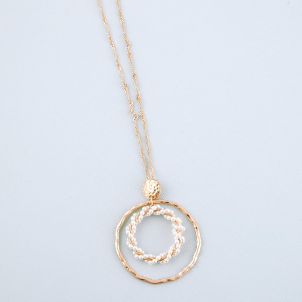 """Long Worn Gold singapore Ivory pearl twist nested pendant necklace.  - Pendant approximately 2.25"""" in diameter - Approximately 30"""" L overall - 3"""" extender"""