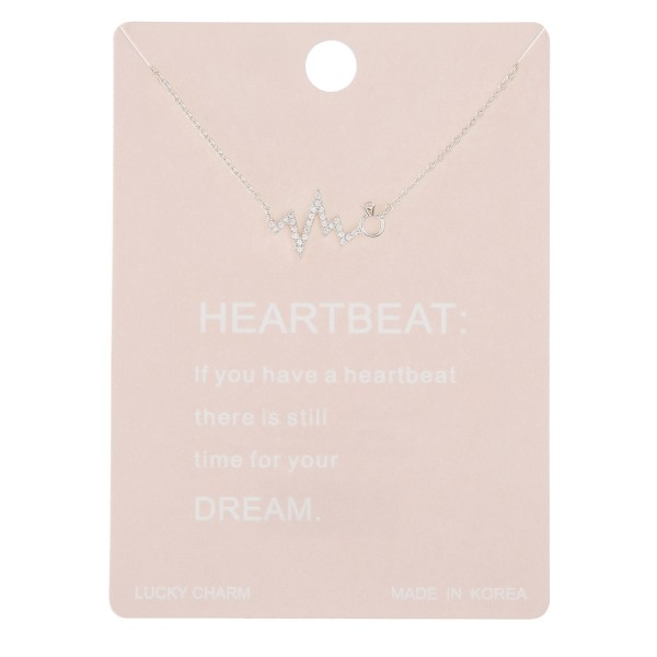 """Dainty rhinestone heartbeat lucky charm necklace with ring detail.  - Pendant approximately .5""""  - Approximately 16"""" in length with 2"""" extender"""