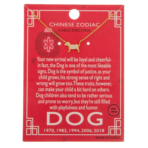 "Gold dipped Chinese Zodiac Cubic Zirconia ""Dog"" pendant necklace.  ""Your new arrival will be loyal and cheerful   in fact, the Dog is one of the most likable   signs. Dog is the symbol of justice, as your   child grows, his strong sense of right and wrong  will grow too. These traits, however, can make   your child a bit hard on others. Dog children also  tend to be rather serious and prone to worry, but  they're still filled with playfulness and humor.""   ""1970, 1982, 1994, 2006, 2018""  - Pendant approximately 1cm  - Approximately 16"" in length"