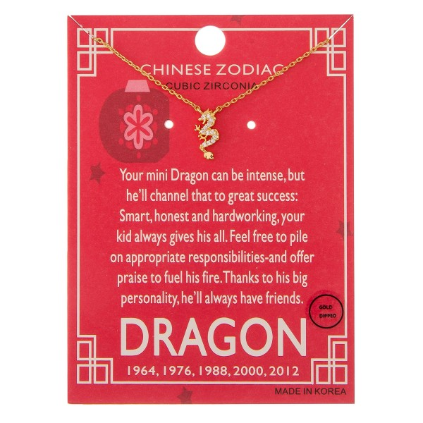 """Gold dipped Chinese Zodiac Cubic Zirconia """"Dragon"""" pendant necklace.  """"Your mini dragon can be intense, but   he'll channel that to great success;   Smart, honest and hardworking, your  kid always gives his all. Feel free to pile  on appropriate responsibilities and offer  praise to fuel his fire. Thanks to his big   personality, he'll always have friends."""" """"1964, 1976, 1988, 200, 2012""""   - Pendant approximately 1cm  - Approximately 16"""" in length"""