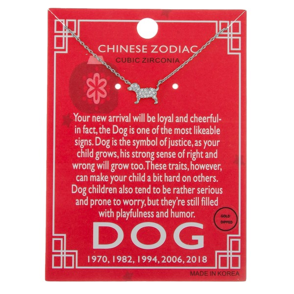 """White Gold dipped Chinese Zodiac Cubic Zirconia """"Dog"""" pendant necklace.  """"Your new arrival will be loyal and cheerful-   in fact, the Dog is one of the most likable   signs. Dog is the symbol of justice, as your   child grows, his strong sense of right and   wrong will grow too. These traits, however,   can make your child a bit hard on others.   Dog children also tend to be rather serious   and prone to worry, but they're still filled   with playfulness and humor.""""   """"1970, 1982, 1994, 2006, 2018""""  - Pendant approximately 1cm  - Approximately 16"""" in length"""