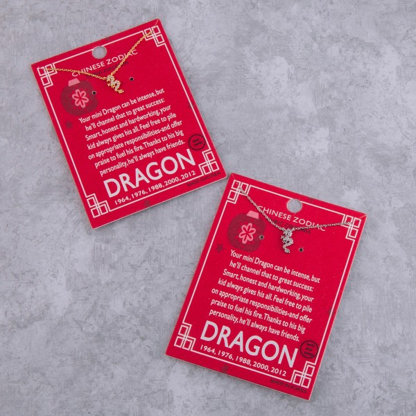 """White Gold dipped Chinese Zodiac Cubic Zirconia """"Dragon"""" pendant necklace.  """"Your mini dragon can be intense, but   he'll channel that to great success;   Smart, honest and hardworking, your  kid always gives his all. Feel free to pile  on appropriate responsibilities and offer  praise to fuel his fire. Thanks to his big   personality, he'll always have friends."""" """"1964, 1976, 1988, 200, 2012""""   - Pendant approximately 1cm  - Approximately 16"""" in length"""