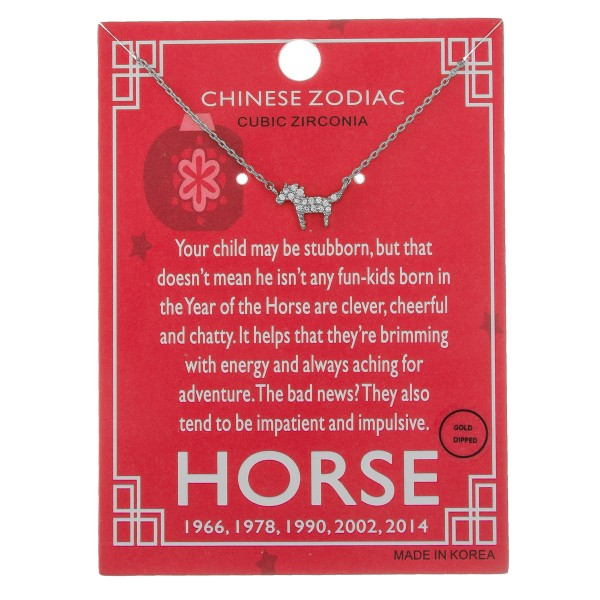 """White Gold dipped Chinese Zodiac Cubic Zirconia """"Horse"""" pendant necklace.  """"Your child may be stubborn, but that   doesn't mean he isn't any fun-kids born   in the Year of the Horse are clever, cheerful   and chatty. It helps that they're brimming  with energy and always aching for adventure.  The bad new? They also tend to be impatient and impulsive."""" """"1966, 1978, 1990, 2002, 2014""""   - Pendant approximately 1cm  - Approximately 16"""" in length"""