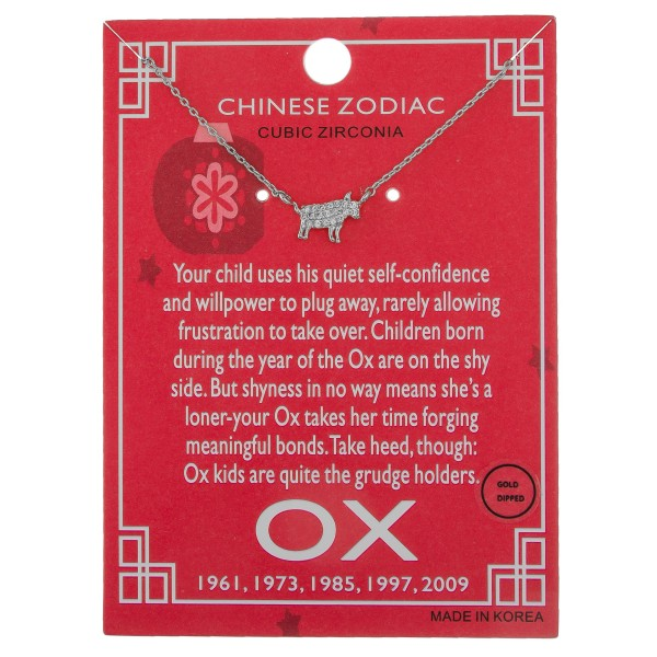 """White Gold dipped Chinese Zodiac Cubic Zirconia """"Ox"""" pendant necklace.  """"Your child uses his quiet self-confidence   and willpower to plug away, rarely allowing   frustration to take over. Children born during   the year of the Ox are on the shy side. But   shyness is no way means she's a loner-your   Ox takes her time forging meaningful bonds.   Take heed, though: Ox kids are quite the   grudge holders."""" """"1961, 1973, 1985, 1997, 2009""""    - Pendant approximately 1cm  - Approximately 16"""" in length"""