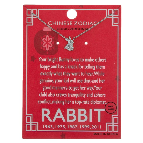 """White Gold dipped Chinese Zodiac Cubic Zirconia """"Rabbit"""" pendant necklace.  """"Your bright Bunny loves to make others  happy, and has a knack for telling them  exactly what they want to hear. While   genuine, your kids will use that and her  good manners to get her way. Your   child also craves tranquility and abhors   conflict, making her a top-rate diplomat."""" """"1963, 1975, 1987, 1999, 2011""""   - Pendant approximately 1cm  - Approximately 16"""" in length"""