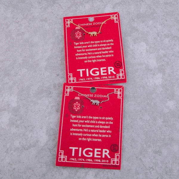 """White Gold dipped Chinese Zodiac Cubic Zirconia """"Tiger"""" pendant necklace.  """"Tiger kids aren't the types to sit quietly.  Instead, your wild child is always on the   hunt for excitement and daredevil adventures.  He's a natural leader who is intensely curious   when he zeros in on the right interest.""""  """"1962, 1974, 1986, 1998, 2010""""   - Pendant approximately 1cm  - Approximately 16"""" in length"""