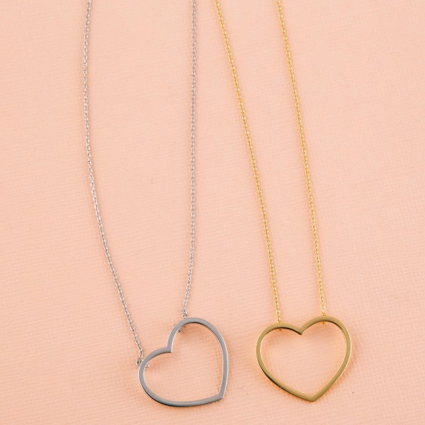 "Gold dipped open heart collar necklace.  - Pendant approximately 1""  - Approximately 14"" in length with 1"" extender"