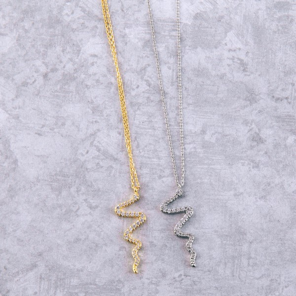 """White Gold dipped cubic zirconia snake pendant necklace.  - Cubic Zirconia  - Pendant approximately 1"""" in length - Approximately 15"""" in length overall with 2"""" extender"""
