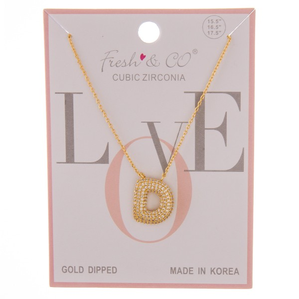 "Gold dipped cubic zirconia initial ""D"" pendant necklace.  - Cubic Zirconia - Pendant approximately .75""  - Approximately 16"" in length with 2"" extender"