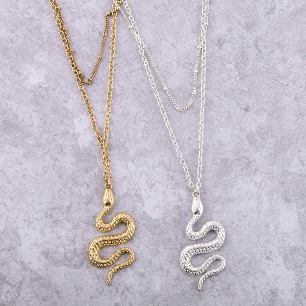 """Metal layered designer inspired snake pendant necklace.  - Pendant approximately 1.75""""  - Shortest layer approx. 14""""  - Approximately 20"""" L  - 3"""" extender"""