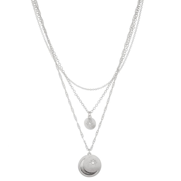 """Metal layered moon stamped coin necklace with north star rhinestone accents.  - Pendant approximately 1"""" in diameter - Shortest layer approx. 14"""" L - Approximately 20"""" L overall  - 3"""" extender"""