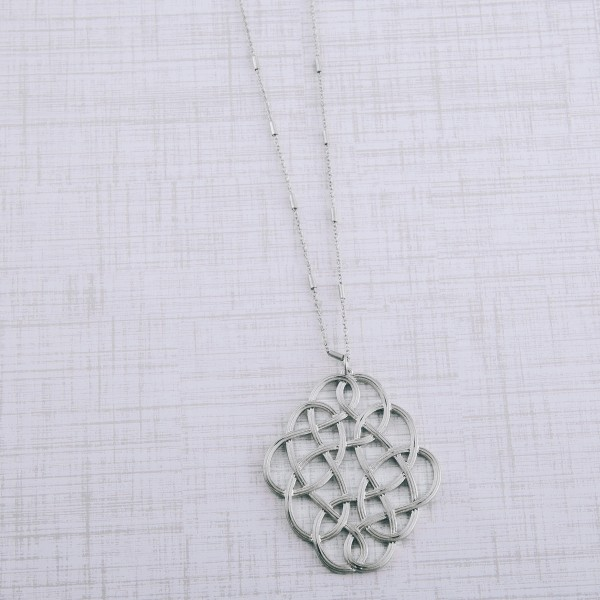 "Long metal filigree loop pendant necklace.  - Pendant approximately 2.5""  - Approximately 32"" L with 3"" extender"
