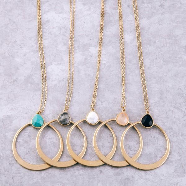"Long metal encased semi precious disc pendant necklace.  - Pendant approximately 2"" in diameter - Approximately 34"" L  - 3.5"" extender"