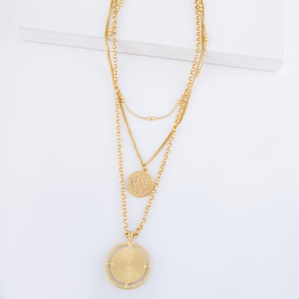 "Chain Link Layered Coin Necklace in Matte Gold.  - Coin Pendant 1.25""  - Shortest Layer 14"" L - Approximately 22"" L overall - 3"" Adjustable Extender"