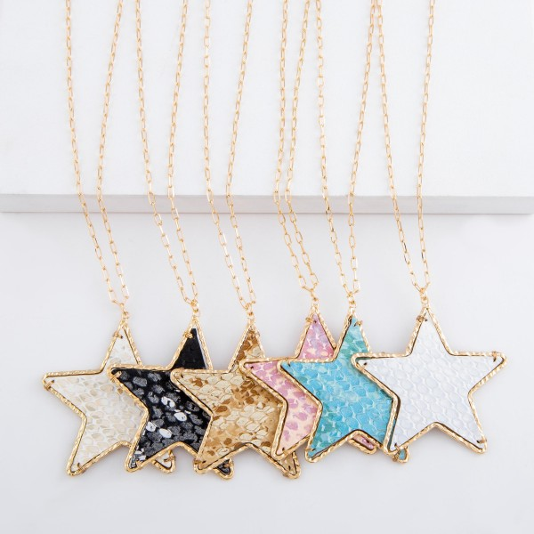 "Long Brass faux leather snakeskin star pendant necklace with metallic accents.  - Pendant approximately 2.25""  - Approximately 32"" L  - 3"" extender"