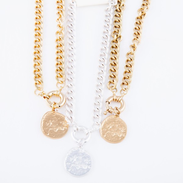 "Curb Chain Link Coin Necklace Featuring a Front Clasp Closure In Worn Gold.  - Pendant 1""  - Front Clasp Closure - Approximately 14"" L  - 2.5"" Adjustable Extender"