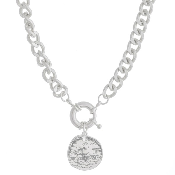 "Curb Chain Link Coin Necklace Featuring a Front Clasp Closure In Worn Silver.  - Pendant 1""  - Front Clasp Closure - Approximately 14"" L  - 2.5"" Adjustable Extender"