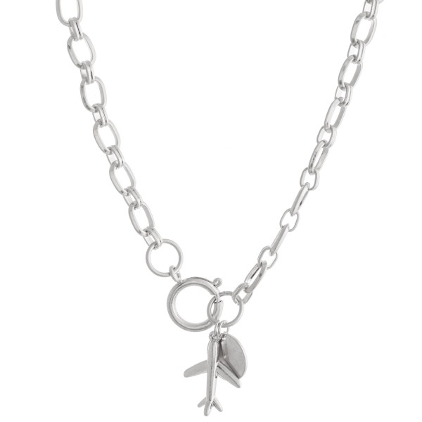 "Chain Link Airplane Pendant Necklace Featuring a Front Clasp Closure in Worn Silver.  - Pendant 1""  - Front Clasp Closure - Approximately 16"" L"