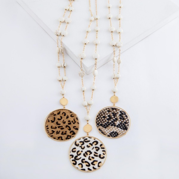 """Long semi precious beaded faux leather snakeskin disc pendant necklace.  - Pendant approximately 3""""  - Approximately 36"""" L overall  - 3"""" extender"""