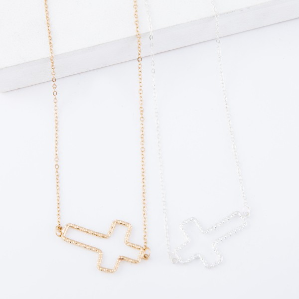 """Textured Gold Metal East West Cross Necklace.  - Cross Pendant 1.25"""" L - Approximately 16"""" overall - 3.5"""" Adjustable Extender"""
