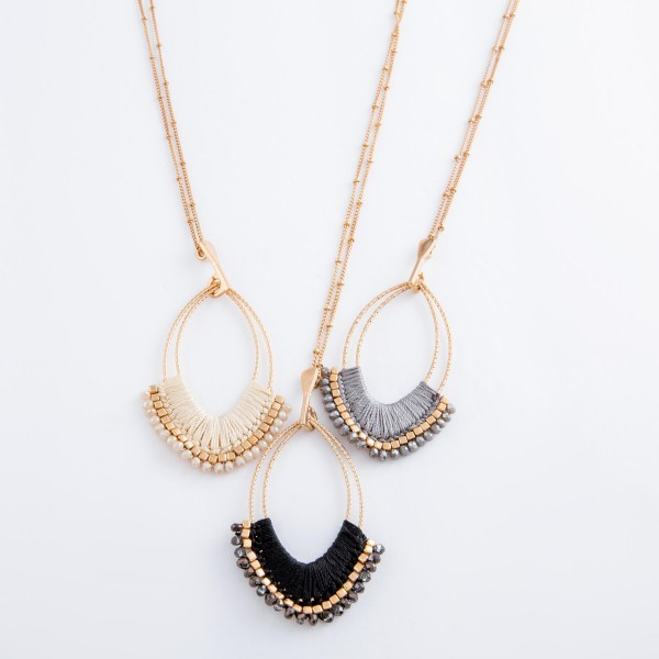 """Long Gold thread wrapped oval pendant necklace with beaded details.  - Pendant approximately 3"""" L - Approximately 36"""" L overall  - 3"""" extender"""