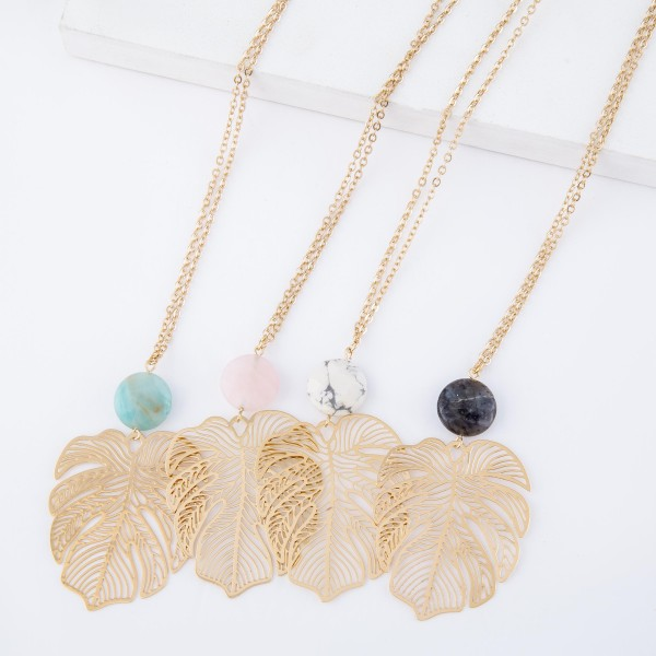 "Long Gold Filigree Palm Leaf Necklace with Natural Stone Accent.  - Pendant 2.5""  - Approximately 38"" L  - 3"" Adjustable Extender"