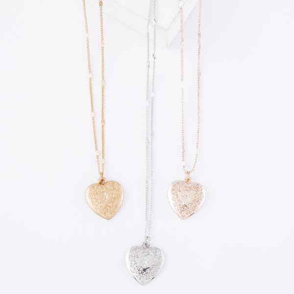 "Short chain necklace featuring an engraved heart pendant.  - Approximately 16"" L with a 3"" extender  - Pendant is approximately .5"" in diameter"