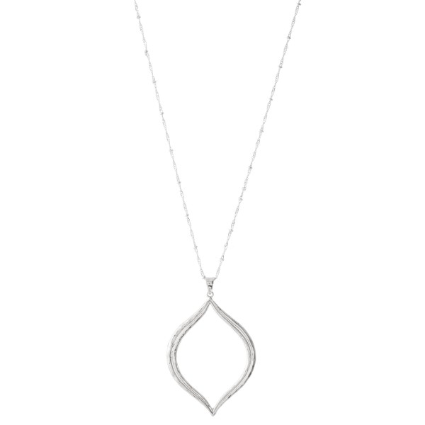 "Long chain necklace featuring a textured pendant.  - Approximately 36"" L with a 3"" extender  - Pendant is approximately 2"" L"