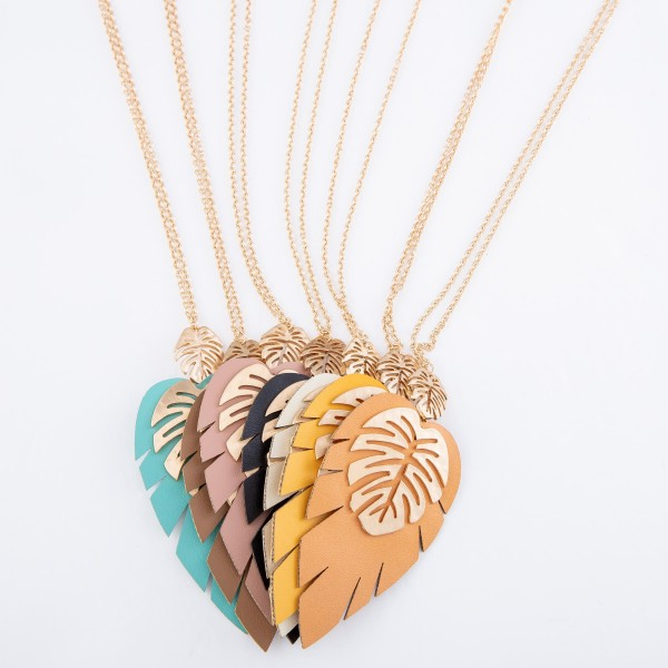 "Long Gold Necklace Featuring a Faux Leather Palm Leaf Pendant with Gold Palm Leaf Accents.  - Pendant 3.5""  - Approximately 36"" L  - 3"" Adjustable Extender"