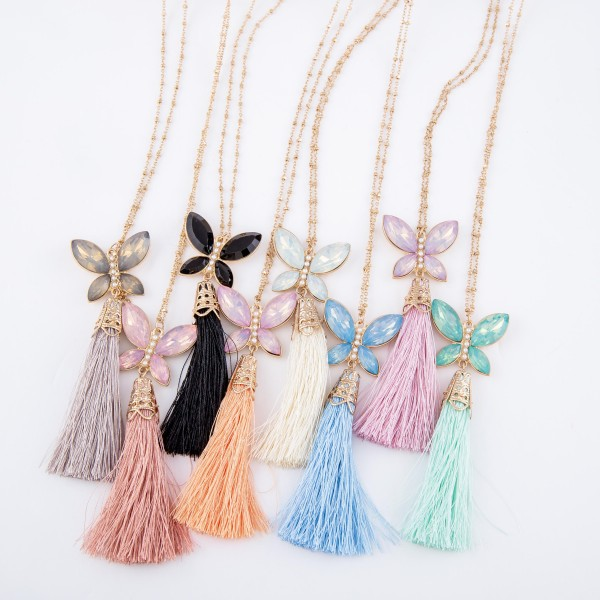 "Long Gold Necklace Featuring Rhinestone Butterfly Tassel Pendant.  - Pendant 3""  - Approximately 38"" L  - 3"" Adjustable Extender"