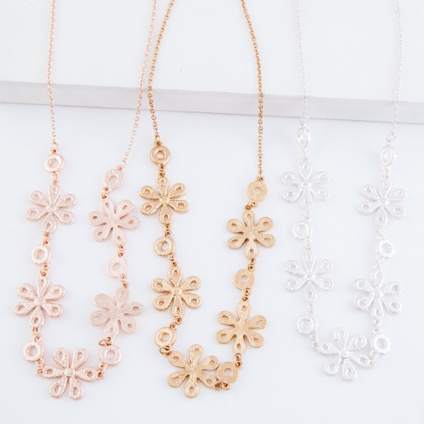 "Metal flower bib necklace.  - Approximately 15"" L  - 3"" extender"