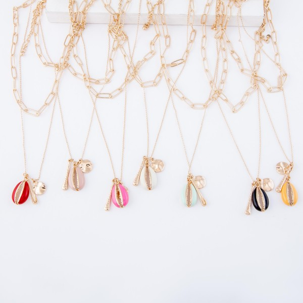 """Double layered necklace featuring a gold chain, gold drop accents, and a colored enamel puka shell pendant.  - Approximately 18"""" L with a 3"""" extender"""
