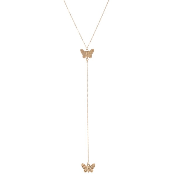 "Gold Y necklace featuring a thin chain and butterfly pendants  - Approximately 16"" L, Y pendant is approximately 26"" L  - Features a 3"" extender"