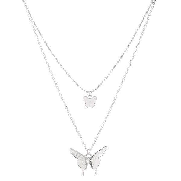 "Short Double layered silver necklace with butterfly pendants.  - Shorter chain measures approximately 14"" L & longer chain measures approximately 17"" L  - Features a 3.5"" extender"
