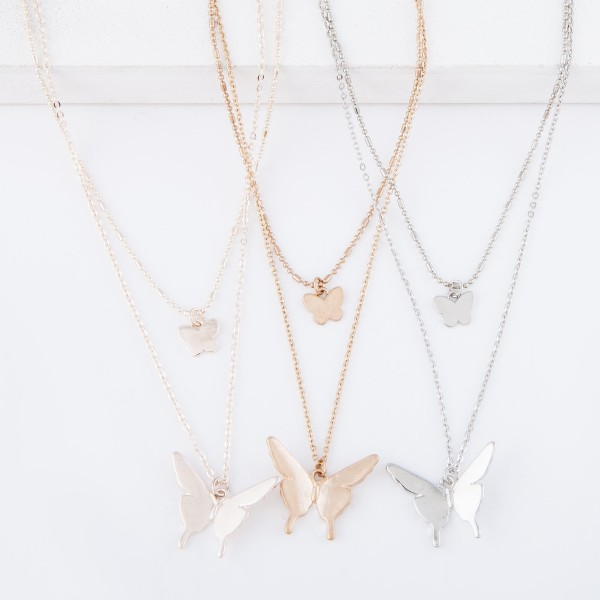 """Short Double layered silver necklace with butterfly pendants.  - Shorter chain measures approximately 14"""" L & longer chain measures approximately 17"""" L  - Features a 3.5"""" extender"""