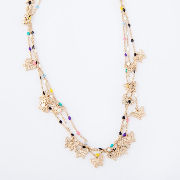 "Short gold necklace featuring beaded accents and small filigree butterfly charms.  - Approximately 16"" L with 3"" extender"