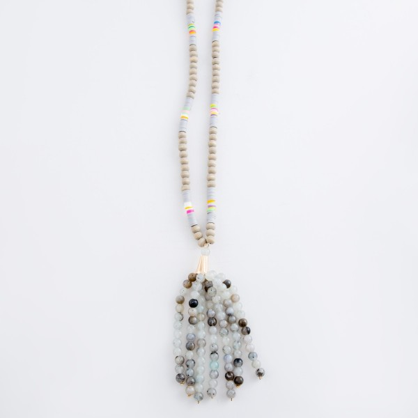 "Long Wood Beaded Semi Precious Beaded Tassel Necklace with Multicolor Spacer Bead Details.  - Tassel approximately 4""  - Approximately 36"" L overall - 3"" extender"