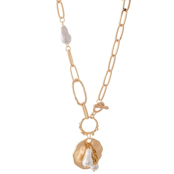 "Chunky Gold Toggle Bar Necklace Featuring Ivory Pearl Details.  - Pendant 2"" L - Approximately 20"" L"
