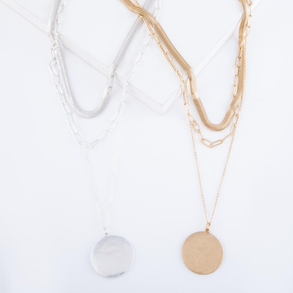 """Herringbone Chain Link Layered Coin Necklace in Worn Gold.  - Pendant 1.25"""" in diameter - Shortest Layer 12"""" L - Approximately 20"""" L overall - 2"""" Adjustable Extender"""