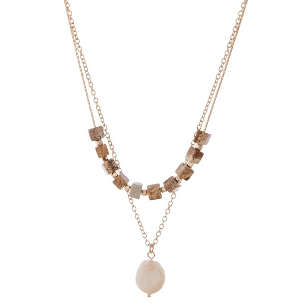 "Semi precious faux pearl layered necklace.  - Pearl approx. 1cm in diameter - Shortest layer approximately 15"" L  - Approximately 18"" L overall - 3"" extender"