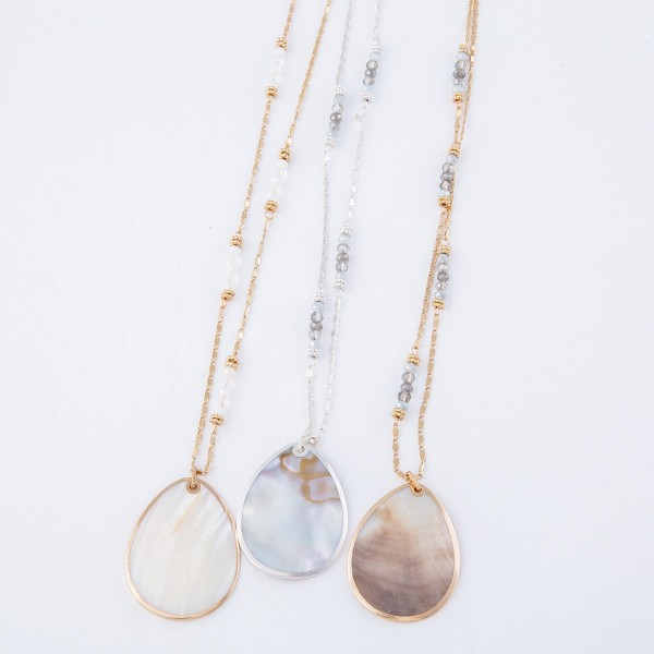 "Long Necklace with Mother of Pearl Shell Teardrop Pendant and Beaded Accents.  - Pendant 1.75"" - Approximately 36"" L overall - 3"" Adjustable Extender"