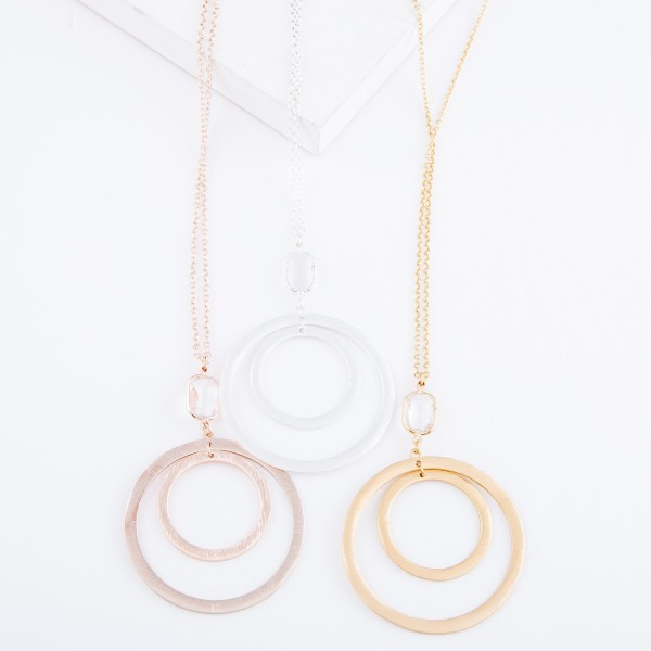 """Long Necklace Featuring Nested Circle Pendant with Crystal Clear Accent.  - Pendant 3"""" L & 2"""" in diameter - Approximately 36"""" L  - 3"""" Adjustable Extender"""
