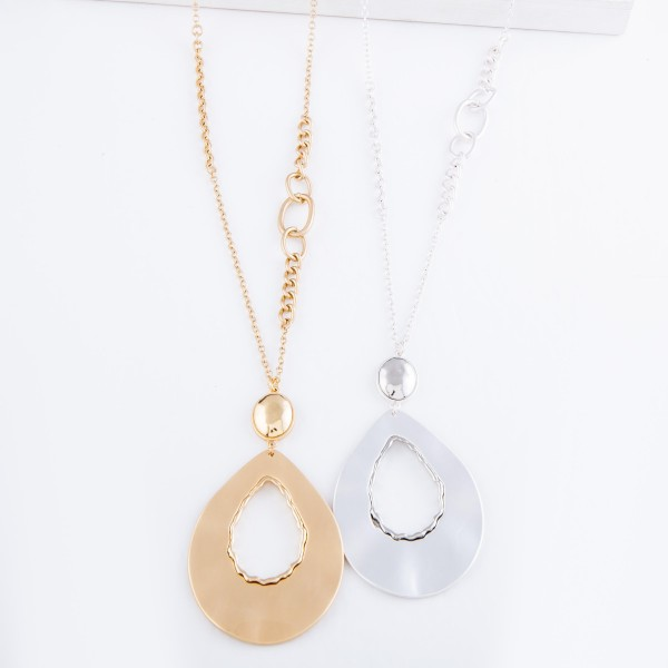 """Long Chain Necklace Featuring Cut Out Teardrop Pendant and Metal Tone Accent.  - Pendant 3"""" - Approximately 36"""" L  - 3"""" Adjustable Extender"""