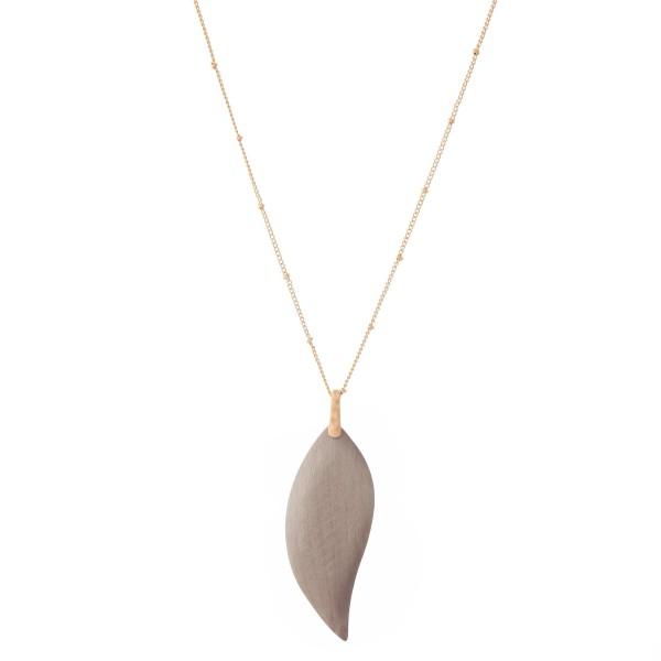 "Long Necklace Featuring Wooden Leaf Pendant.  - Pendant 2.75"" L  - Approximately 36"" L  - Adjustable 3"" Extender"