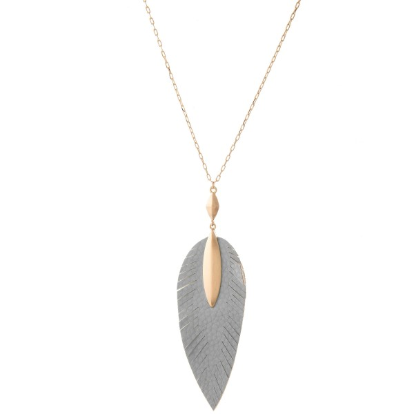"Long Necklace Featuring Faux Leather Leaf Pendant in Gold.  - Pendant 4.25"" L  - Approximately 38"" L  - Adjustable 3"" Extender"