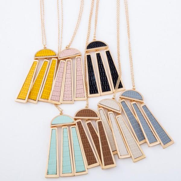 "Long Necklace Featuring Metal Encased Faux Leather Metal Tassel Pendant.  - Pendant 3"" L - Approximately 36"" L  - Adjustable 3"" Extender"